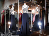 You will definitely be the star in this navy hot jersey number! The sweetheart illusion bodice is detailed with sparkling silver embellishments with wide straps that cascade into a low illusion back. So sophisticated and it's at Rsvp Prom and Pageant, your source for the hottest 2016 Prom Dresses!