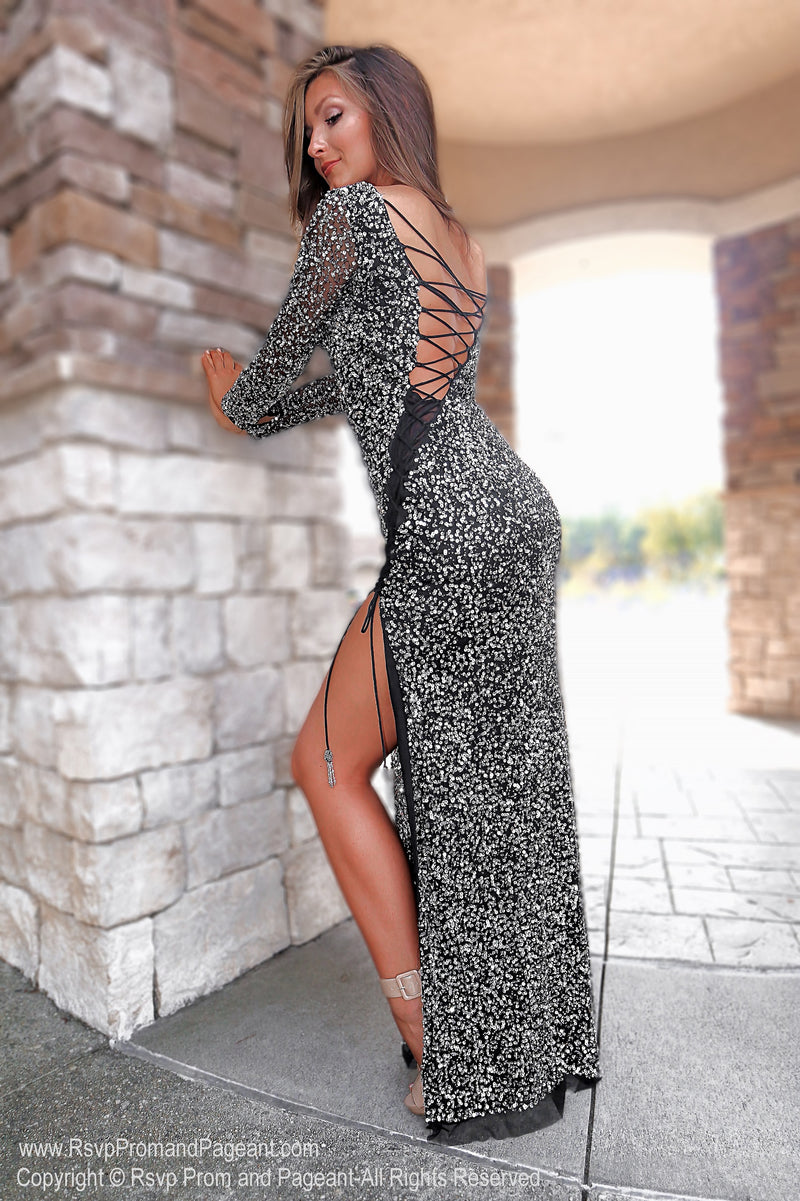 Back of Black/Silver Fully Beaded Prom Dress With Sleeves at Rsvp Prom and Pageant, the largest Atlanta prom dress store also known as Promheaven