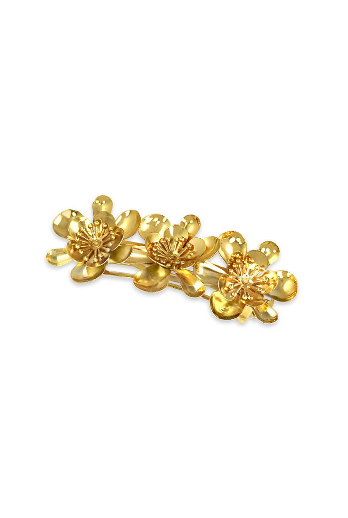Three gold metal flower hair barrette
