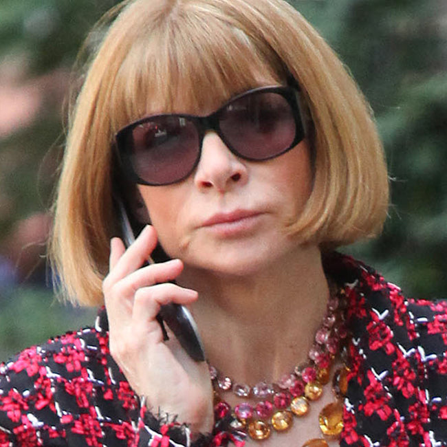 April 17, 2013:  Anna Wintour totes a Chanel shopping bag while chatting on her cell phone in New York City. Mandatory Credit: Mauceri/MacFarlane/INFphoto.com  Ref: infusny-141/240