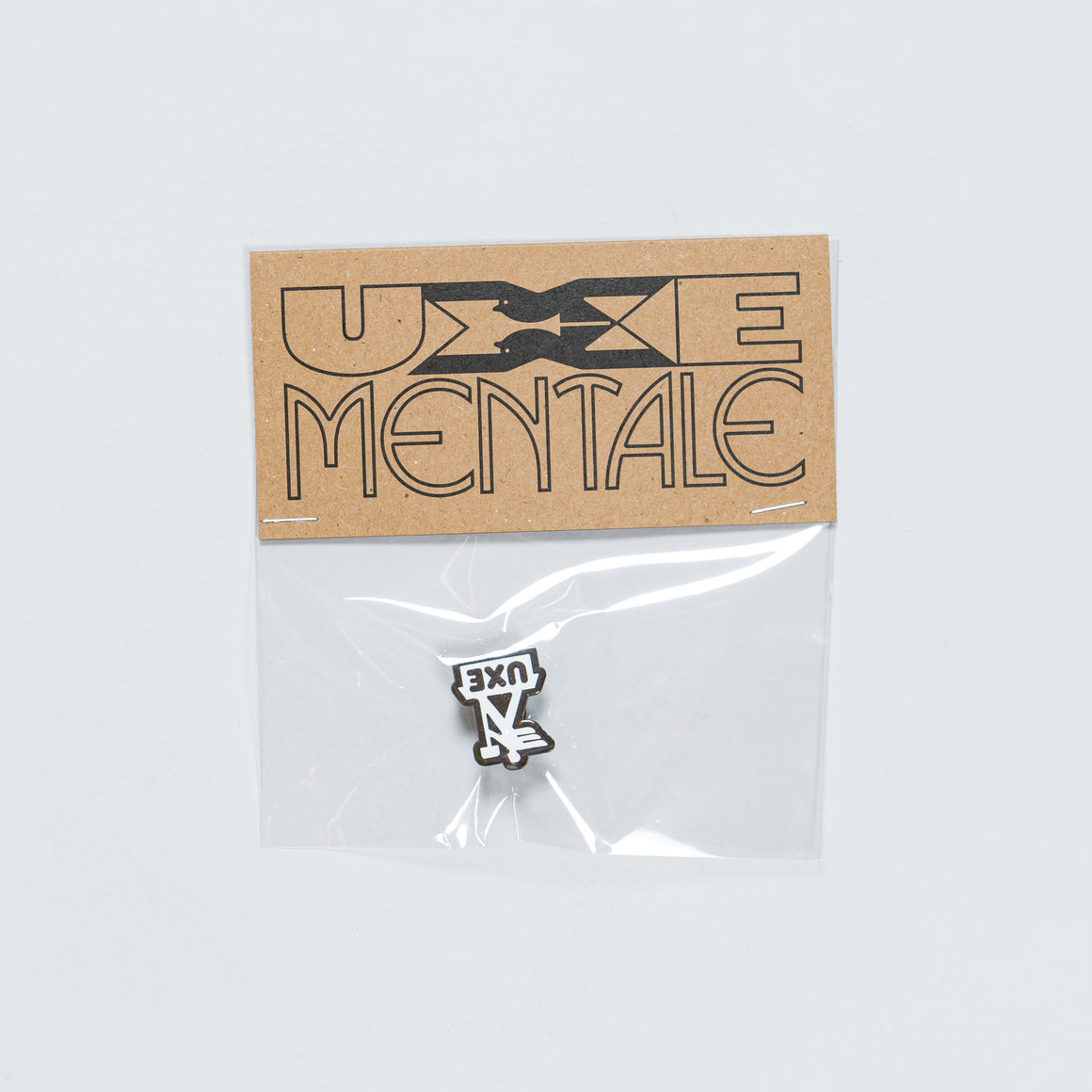 Uxe Mentale - Postman Enamel Pin - Black/White - Up There