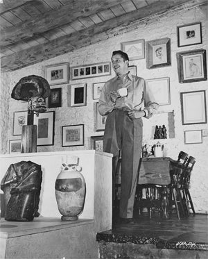 Vincent Price surrounded by Art
