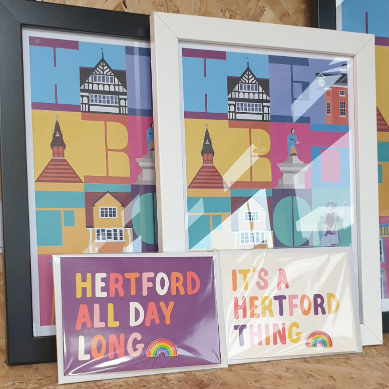 Hannah Bailey It's a Hertford Thing white postcard and enamel pin badge displayed