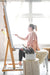 Dana Mooney Vancouver Artist painting at her easle in a bright, light filled art studio