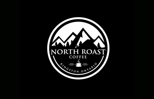 A circular north Roast coffee logo appears on a pure black background.  The north Roast logo is all black and white with graphic of mountains in the back and North Roast Coffee text overlaid.