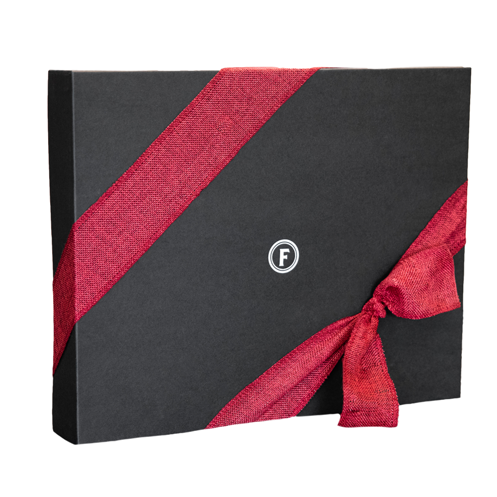 large elegant black gift box with red ribbon, ferris circle f centered