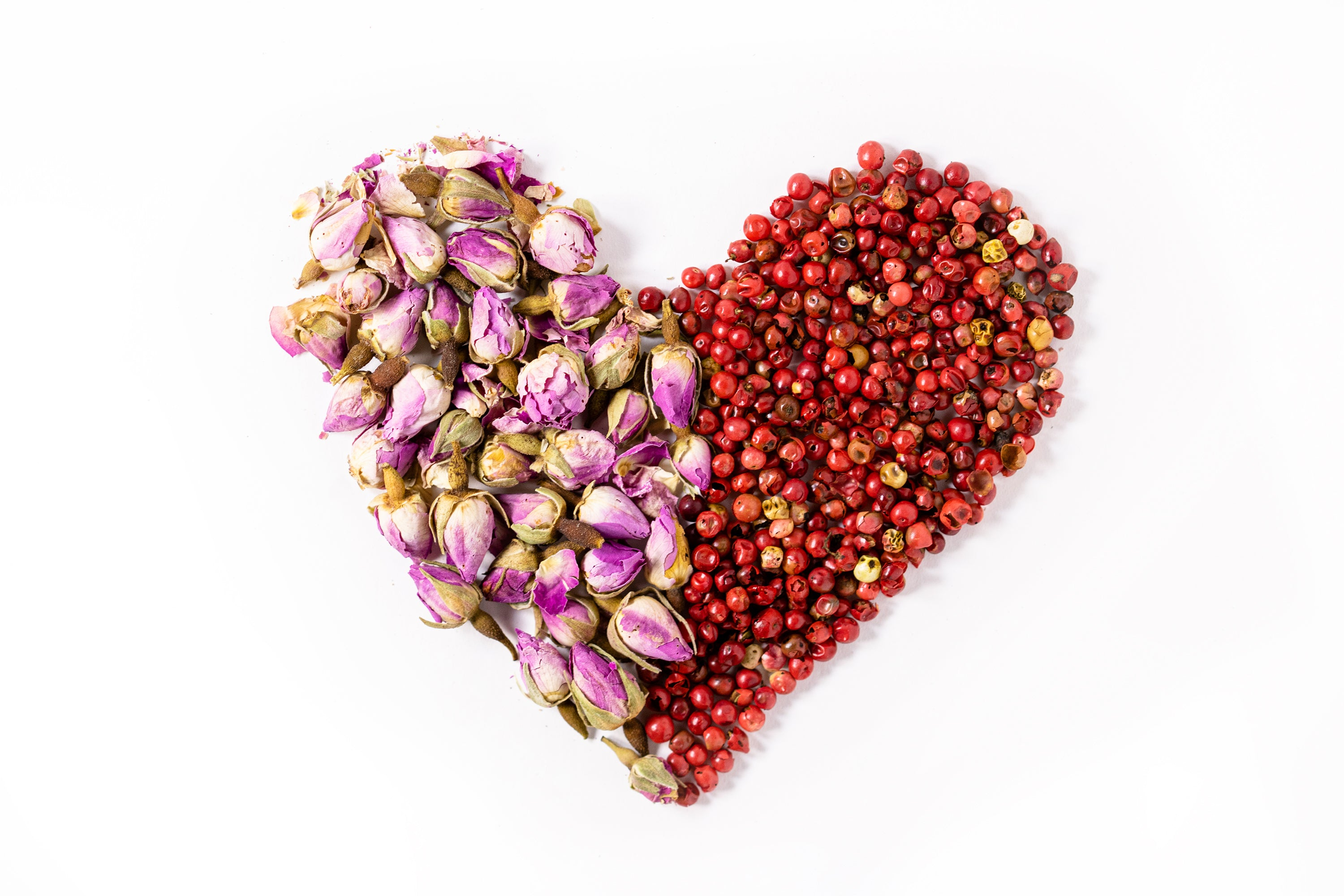 rosebuds and pink peppercorn in shape of heart