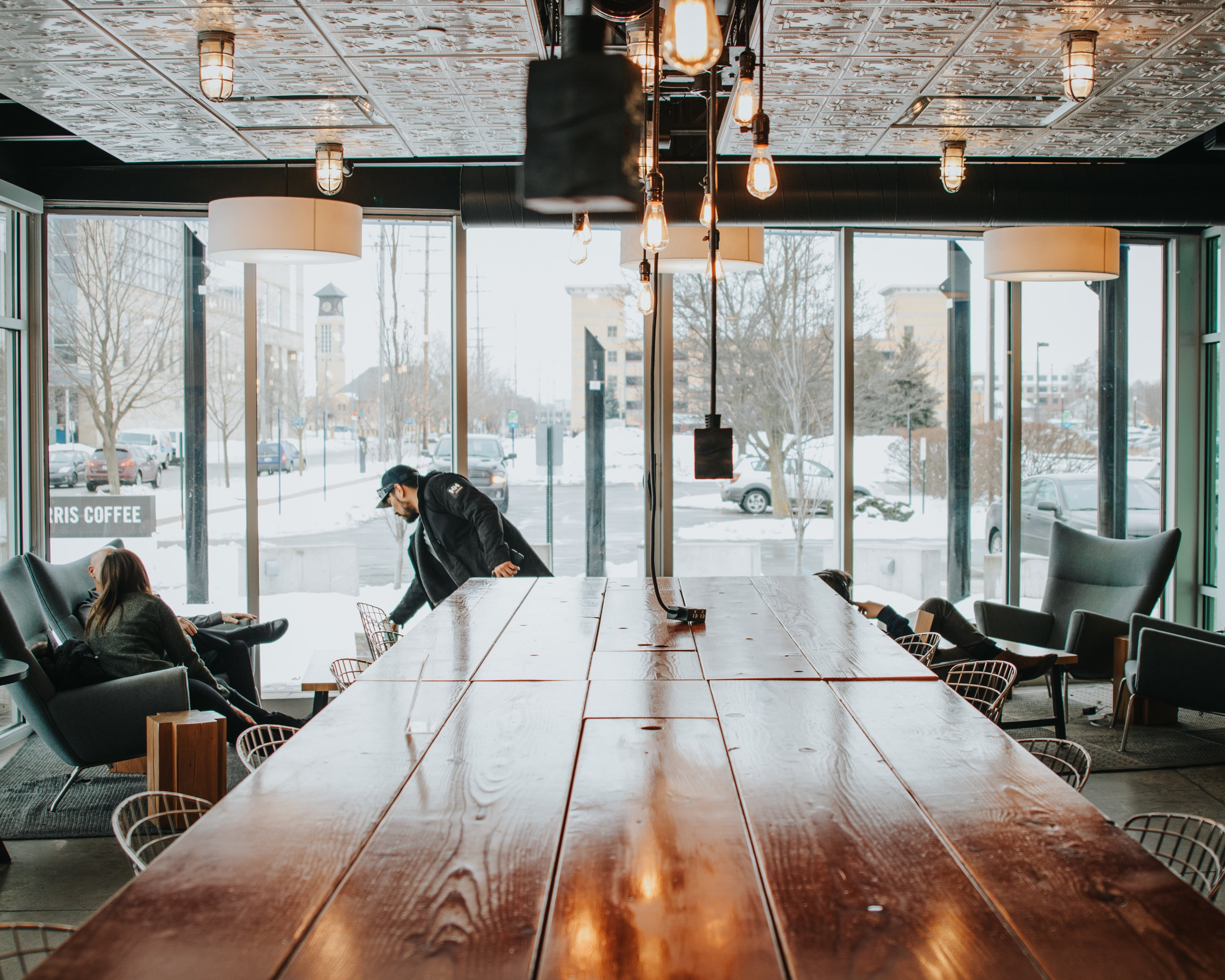 cafe setting with large wooden table