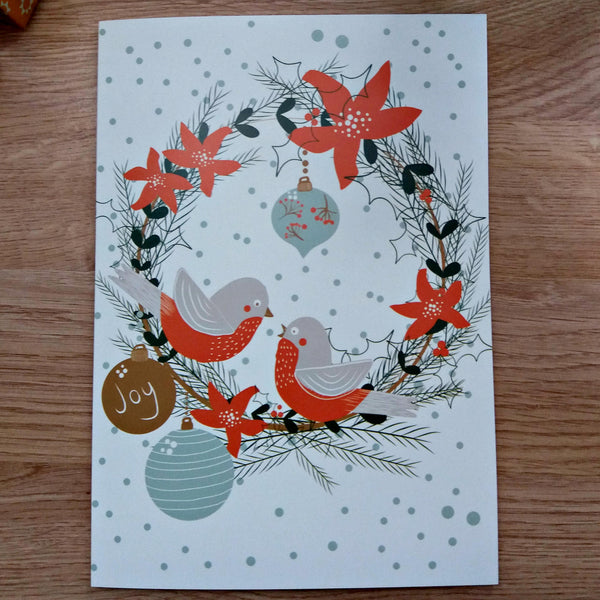 set of four whimsical christmas cards with festive holidays illustrations (robins, wreaths, ornaments, gifts) - Edith May Designs