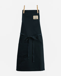 Durable navy blue full length cross back chef/kitchen apron with one pocket and adjustable ties.