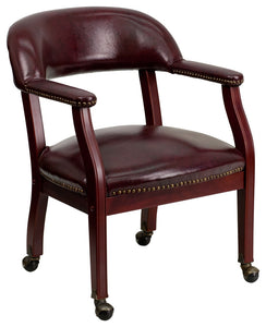 Oxblood Vinyl Luxurious Conference Chair with Accent Nail Trim and Casters