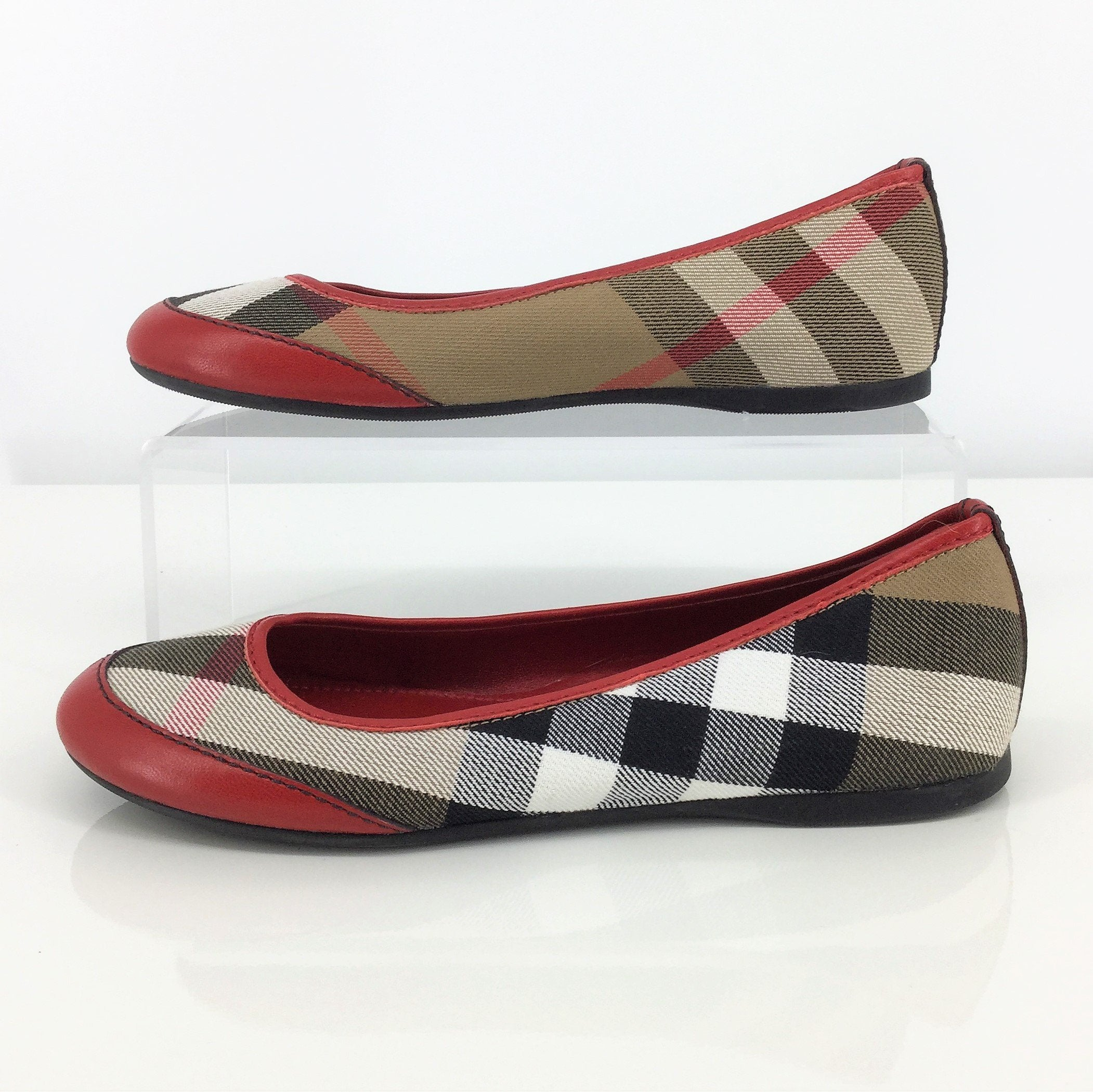 Burberry Flats Size:4 - <p>like new flats. signature burberry plaid canvas with red leather trim and toes. adult size 4.</p>