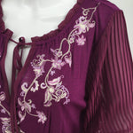 White House Black Market Top - <p>brand new whbm long sleeve top. with the floral embroidery, tassel neck decor, and puffed see-through sleeves in a beautiful purple, add this amazing top to your wardrobe for just $35 today.</p>
