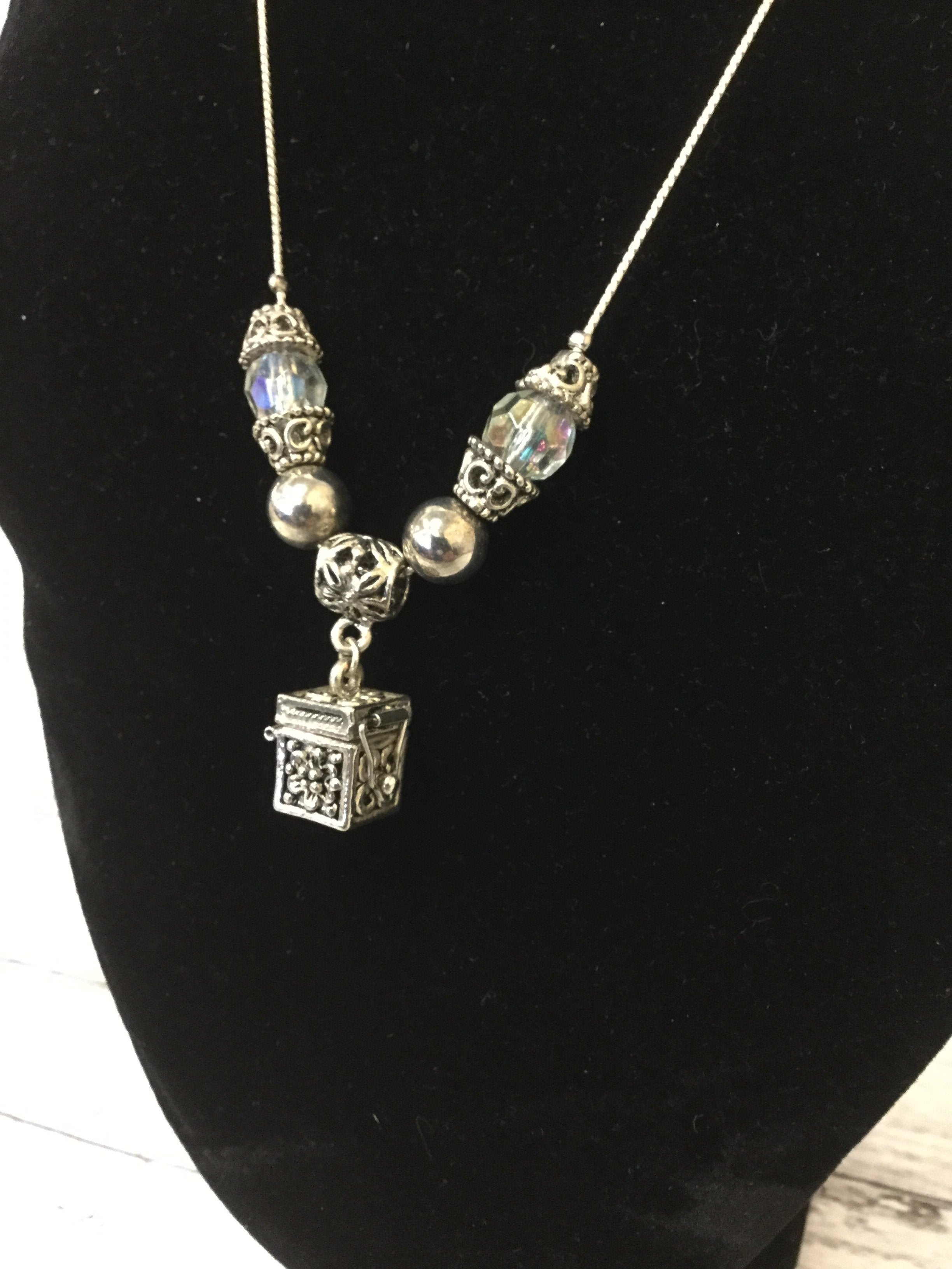 Photo #1 - , style: necklace , color: silver , other info: silver  box , sku: 125-4893, features a silver box that opens.