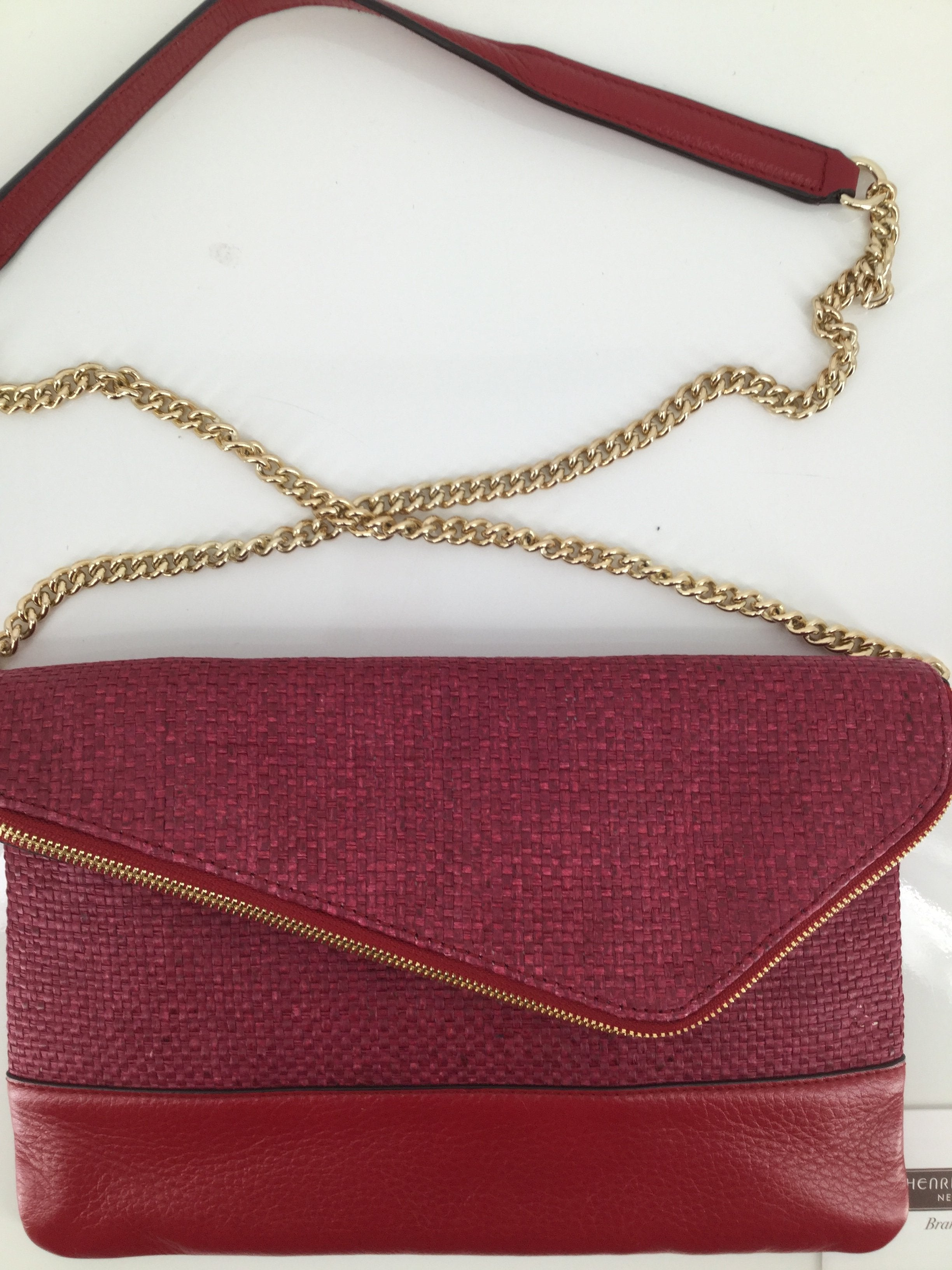 Henri Bendel Handbag Designer Size:medium - <p>beautiful red henri bendel crossbody purse.  gold hardware and partial gold chain with red leather on the over-the-shoulder area.  interior is in excellent condition.  exterior is a woven pattern with leather trim.  asymmetrical opening.  grey interior also with small zippered pocket.</p>