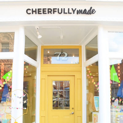 Cheerfully Made storefront featuring a bright yellow door in Almonte Ontario