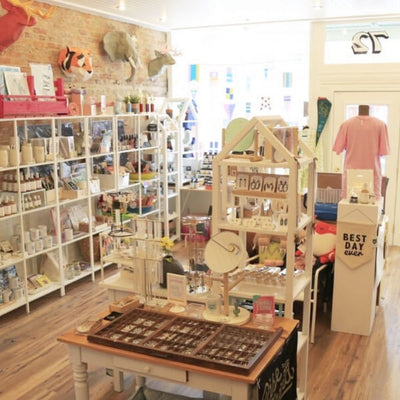 Photograph of the interior of Cheerfully Made Goods featuring a wide range of products on display