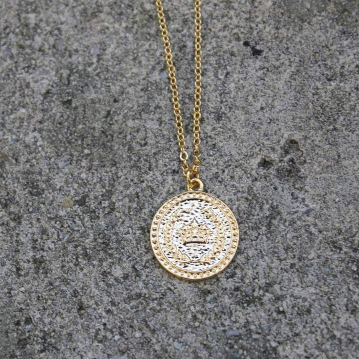 A gold coin necklace with a crown by Vintage Acorn