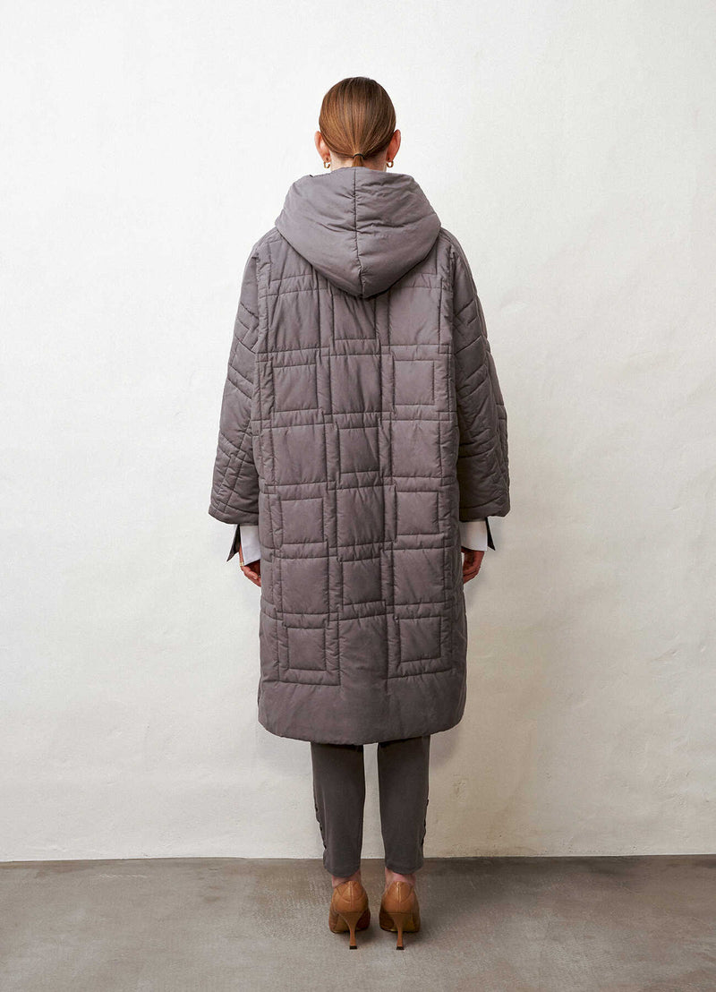 Quilted geometric pattern coat