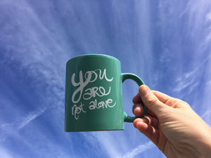 """You are not alone"" Teal Ceramic Mug"