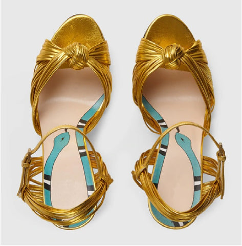 Crawford Knotted Metallic Leather Sandals gold top view with a snake print on in sole