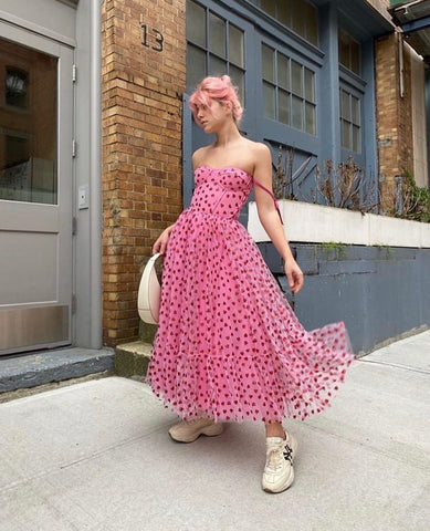 Hearty corset midi dress with model wearing a rubber shoes.