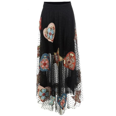 Black Beaded Tulle Maxi Skirt has a colorful front view.