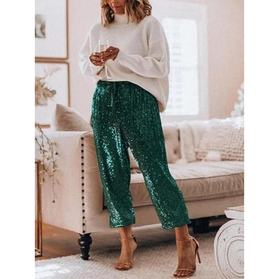 Mid-Rise Sequined Slim Pants holding wine glass