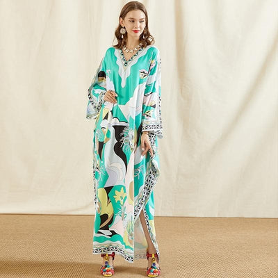 A lady wearing Batwing Sleeve Knitting Loose Maxi Dress front view paired with accessories and colorful sandals.