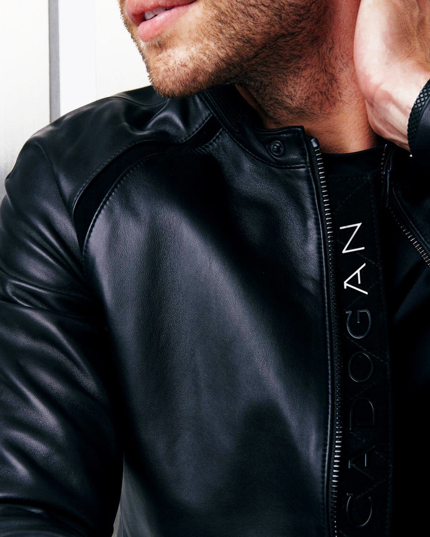 A close look at the shiny black titanium metal CADOGAN Letters down the zipper sleeve of the MAVEN Men's Leather Jacket