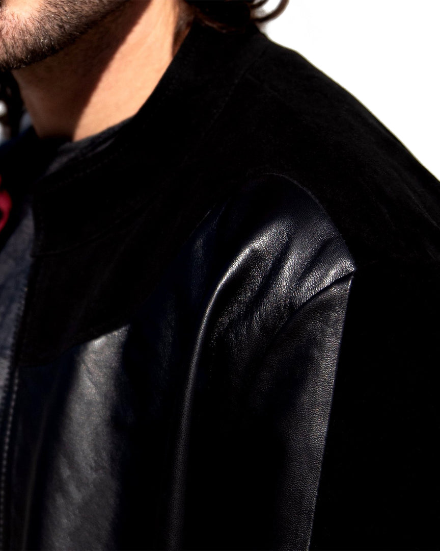 Up close view of the full-grain black leather and black suede of the CADOGAN Men's Leather Jacket