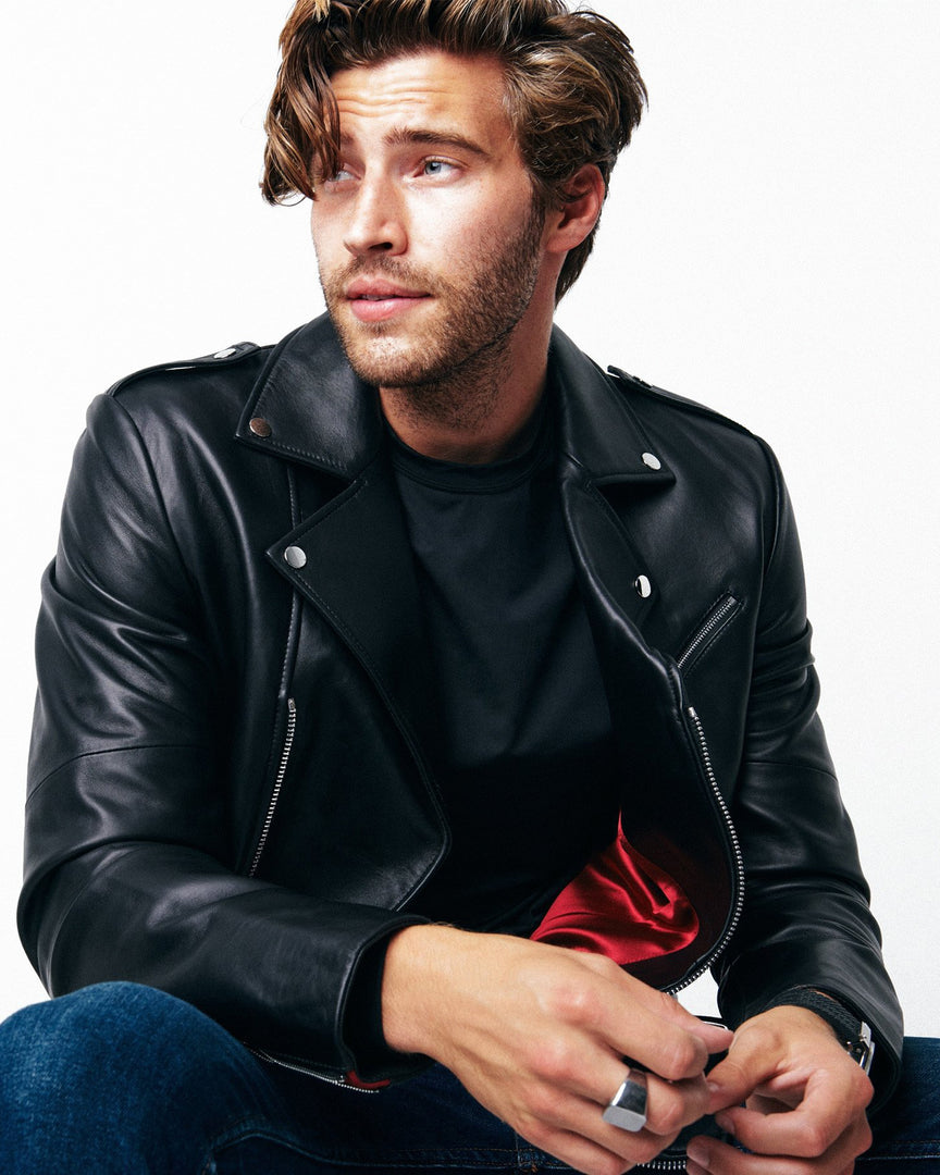 Man sitting in CADOGAN Leather Jacket