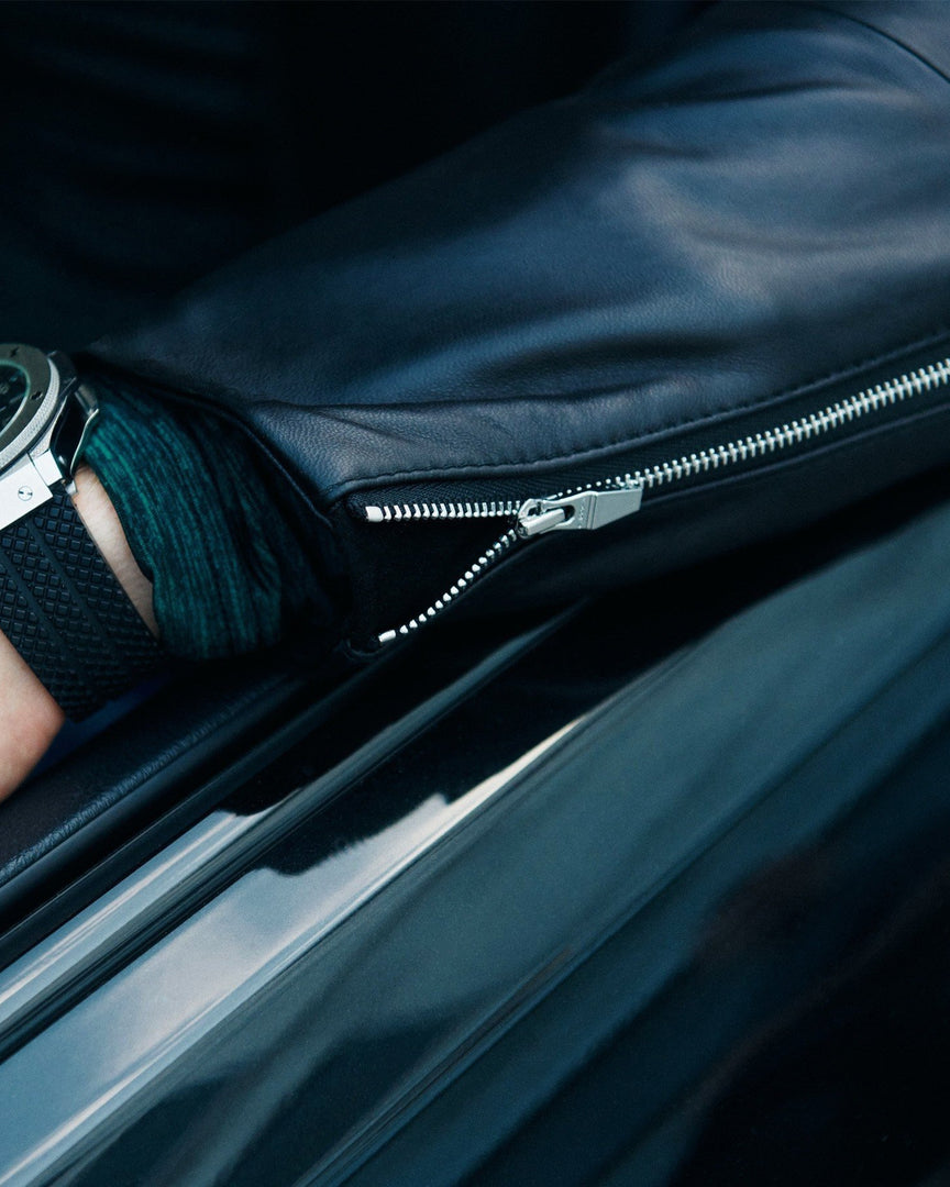 The cuff details and zipper of the XANDER Leather Jacket and a Hublot Big Bang Watch