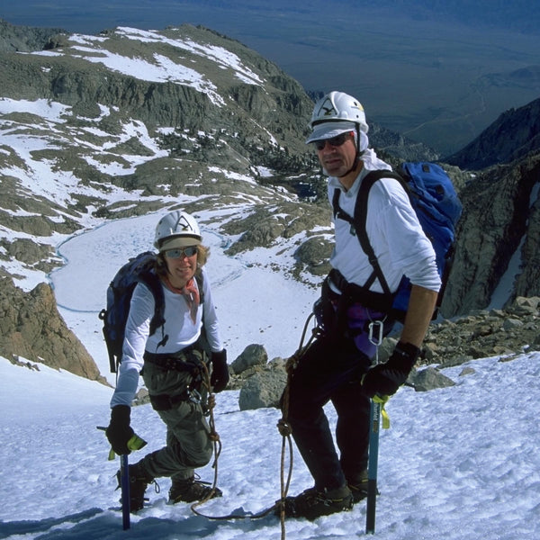 two climbers on a snow field with ice axes and crampons, mt. leConte, Sierra Nevada