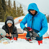 a couple snow camping makes hot food using the sumo stove