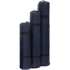 All three sizes of the basecamp sleeping pad rolled up and in stuff bags side by side