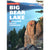 a person climbs a rock tower above Big Bear lake, on the cover of the Big Bear Lakes climbing guide