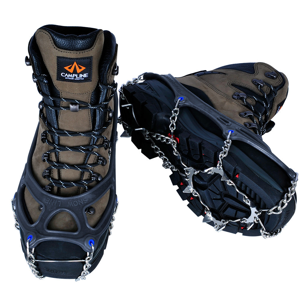 a pair of boots wearing the chainsen pro crampon showing the toe of one boot and the sole of the other