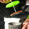 a coffee press being inserted into a jetboil pot