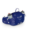 Women's Tempest 6 Pack in Iris Blue, Showing front Zippered Pockets and compression straps and Has two 16oz Water bottles