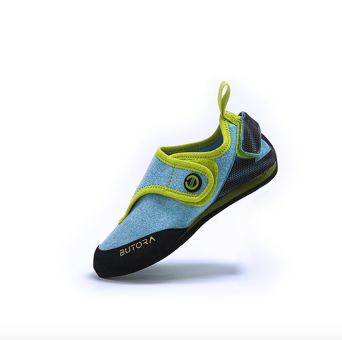 butora kids climbing shoe side view in colors blue with lime green trim