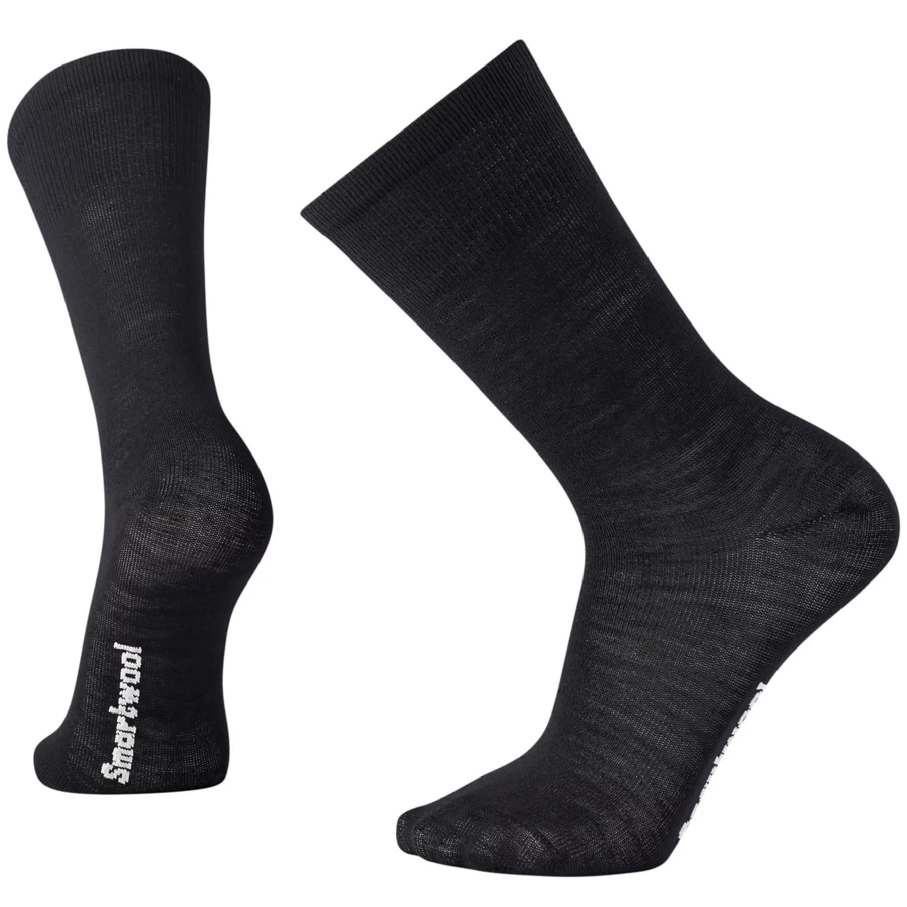 a pair of hiking liner crew socks in black