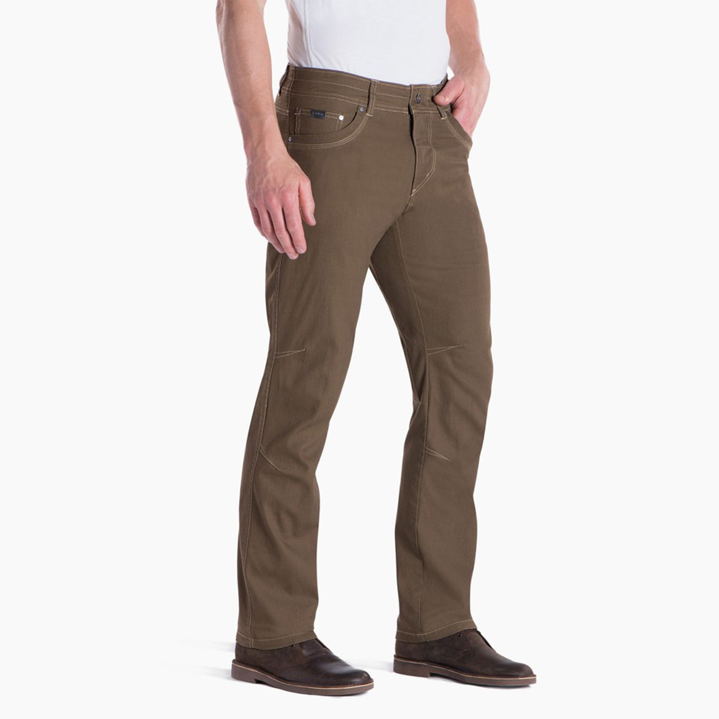 kuhl kanvus jean mens on model three quarter view in color dark khaki brown