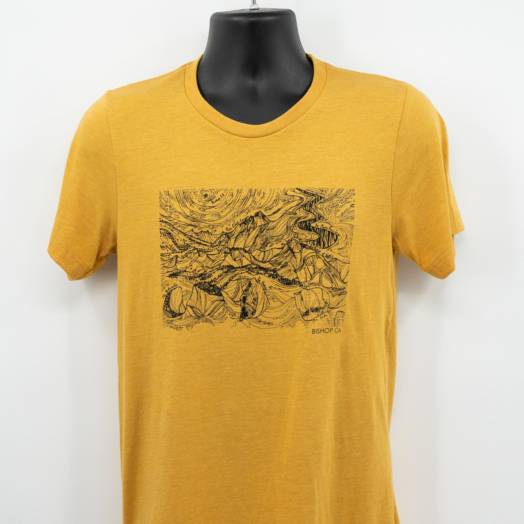 mustard bishop t shirt showing the design on a mannequin