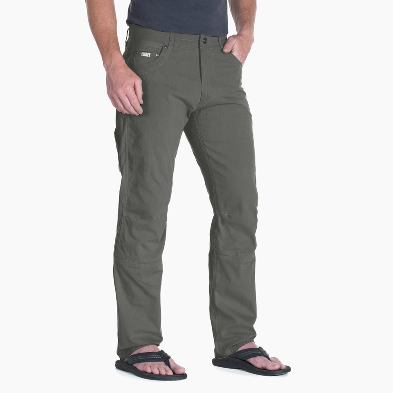 kuhl radikl pants mens on model front view in color green