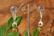 Load image into Gallery viewer, Golden Green Baltic Amber with Crescent Moon Earrings
