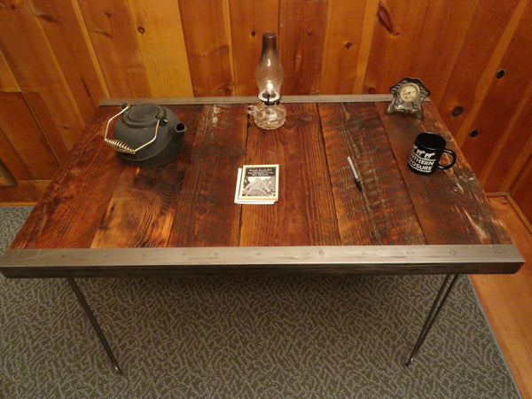 Industrial desk with raw steel trim and hairpin legs
