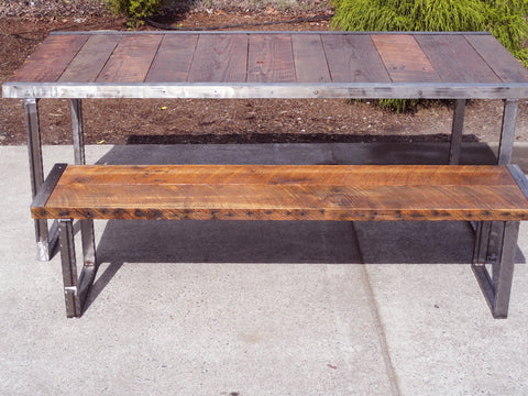 7 ft industrial bench with rectangular steel legs and raw steel trim