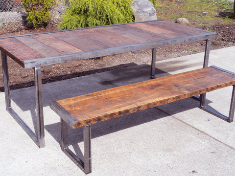 8 ft industrial bench with rectangular steel legs and raw steel trim