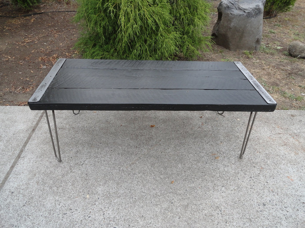 black stained industrial coffee table from old barnwood with